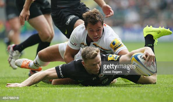 Chris Ashton of Saracens stretches for the opening try during the Aviva Premiership match between Saracens and Wasps at Twickenham Stadium on...