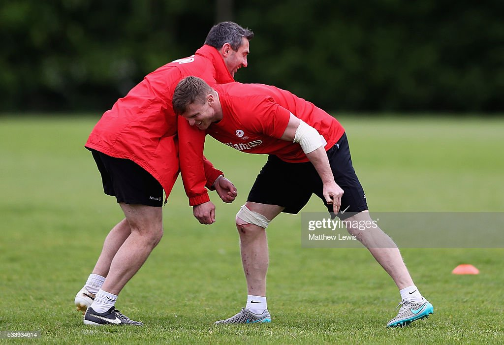 Chris Ashton of Saracens trains with Kevin Sorrell, Backs Coach during a Saracens Training Session on May 24, 2016 in St Albans, England.