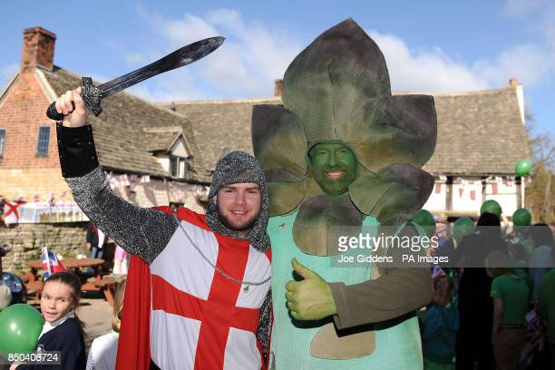 Chris Ayliffe dressed as St George and Gus the Asparagusman celebrate the launch of British asparagus season at The Fleece Inn Bretforton A host of...