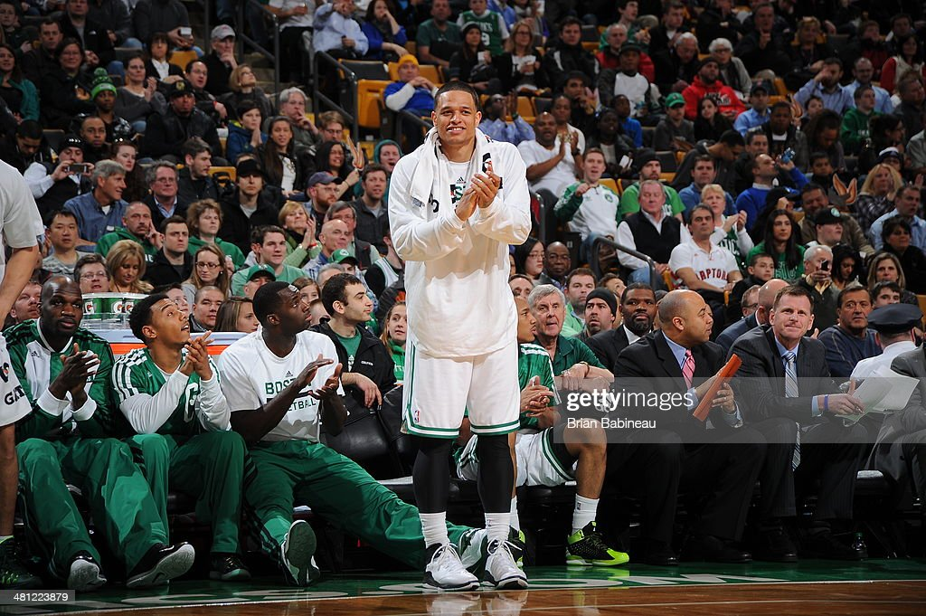 <a gi-track='captionPersonalityLinkClicked' href=/galleries/search?phrase=Chris+Babb&family=editorial&specificpeople=5758599 ng-click='$event.stopPropagation()'>Chris Babb</a> #52 of the Boston Celtics celebrates on the sideline during a game against the Toronto Raptors on March 26, 2014 at the TD Garden in Boston, Massachusetts.