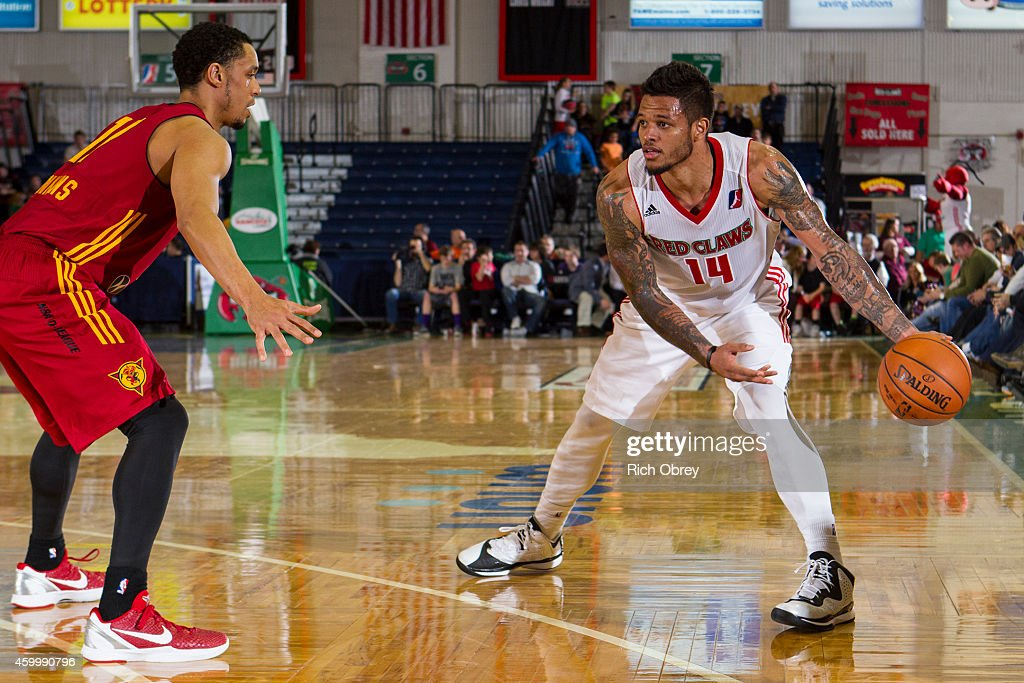 <a gi-track='captionPersonalityLinkClicked' href=/galleries/search?phrase=Chris+Babb&family=editorial&specificpeople=5758599 ng-click='$event.stopPropagation()'>Chris Babb</a> #14 of the Maine Red Claws makes a pass around <a gi-track='captionPersonalityLinkClicked' href=/galleries/search?phrase=John+Jenkins+-+Basketball+Player&family=editorial&specificpeople=9864667 ng-click='$event.stopPropagation()'>John Jenkins</a> #17 of the Fort Wayne Mad Ants goes sprawling on December 4, 2014 at the Portland Expo in Portland, Maine.
