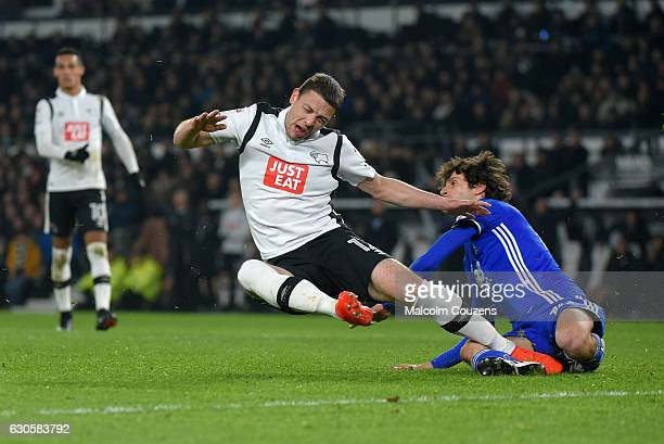 Chris Baird of Derby County falls under a challenge from Diego Fabbrini of Birmingham City during the Sky Bet Championship match between Derby County...