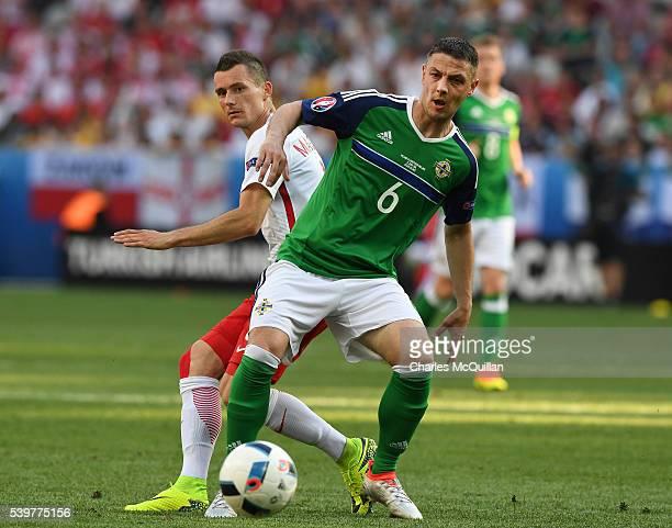Chris Baird of Northern Ireland and Krzysztof MÄczyÅski of Poland during the UEFA EURO 2016 Group C match between Poland v Northern Ireland at...