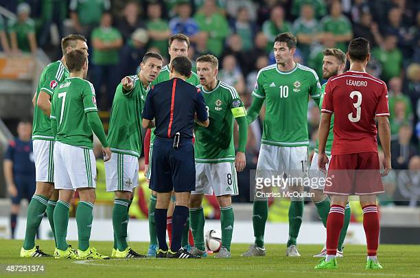 Chris Baird of Northern Ireland is sent off for two bookable offences during the Euro 2016 Group F qualifying match at Windsor Park on September 7...