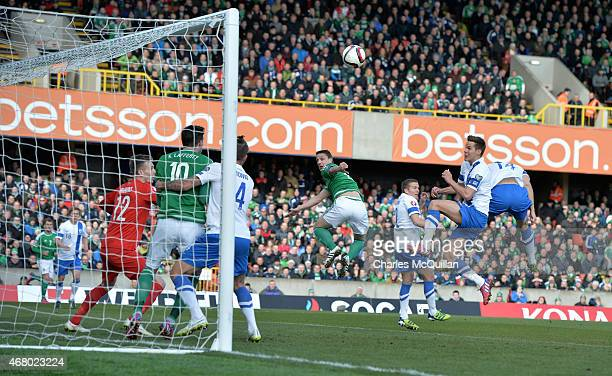 Chris Baird of Northern Ireland sees his header disallowed during the EURO 2016 Group F qualifier at Windsor Park on March 29 2015 in Belfast...