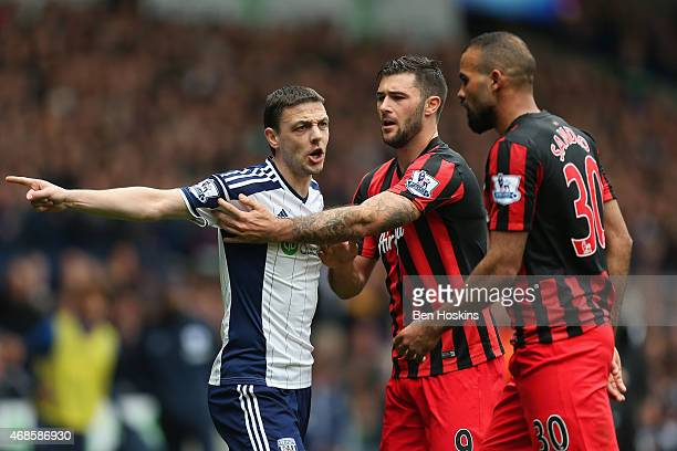 Chris Baird of West Brom is hwld back by Charlie Austin of QPR as he clashes with Sandro of QPR during the Barclays Premier league match West...