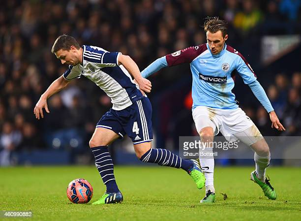 Chris Baird of West Bromwich Albion evades Alex Rodman of Gateshead during the FA Cup Third Round match between West Bromwich Albion and Gateshead at...