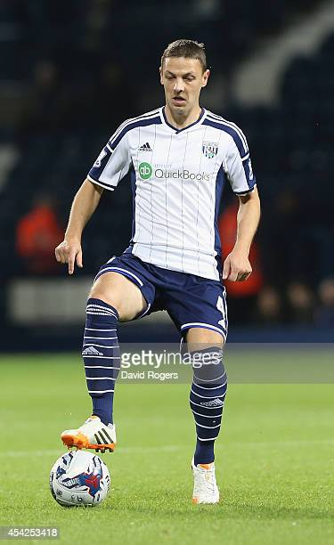Chris Baird of West Bromwich runs with the ball during the Capital One Cup second round match between West Bromwich Albion and Oxford United at The...