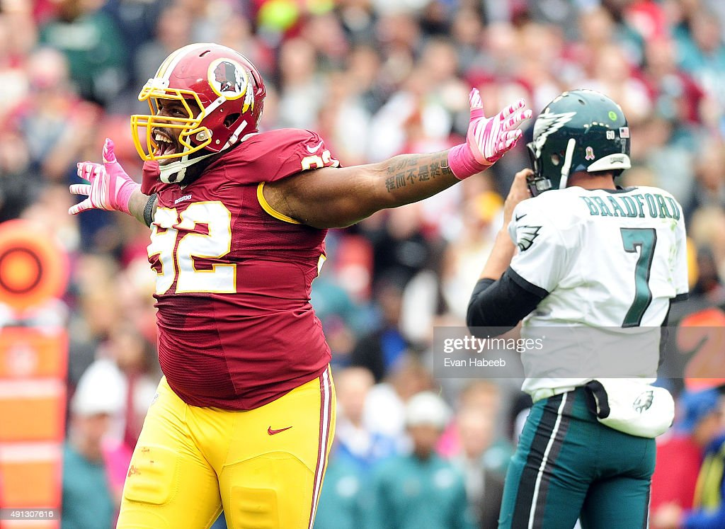 Chris Baker of the Washington Redskins reacts after a sack against Sam Bradford of the Philadelphia Eagles in the second quarter at FedExField on...