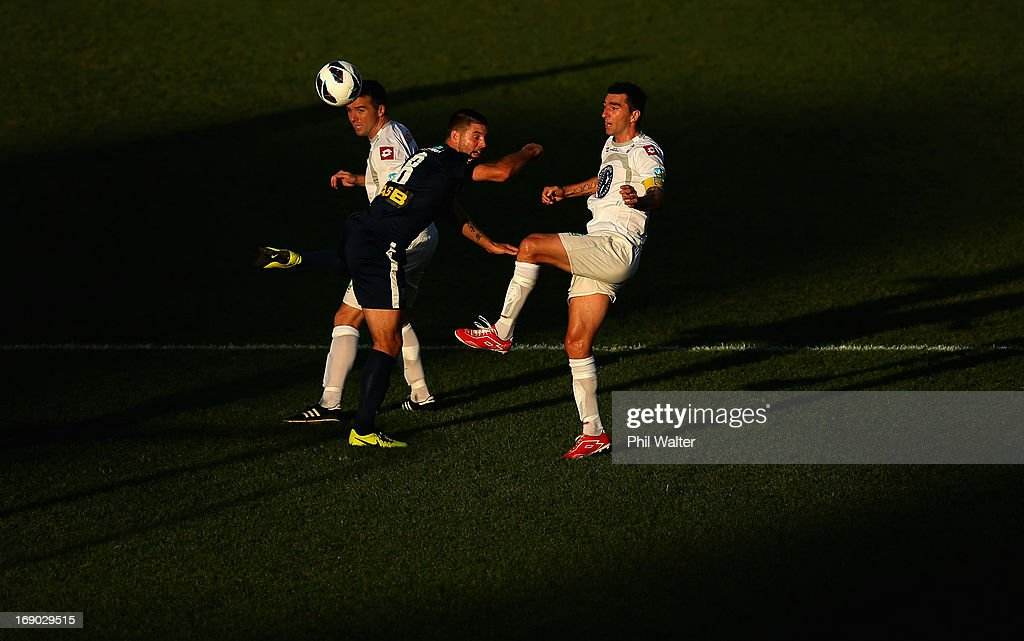 Chris Bale of Auckland City (C) is put under pressure from Brian Shelley (L) and Jake Butler (R) of Waitakere during the OFC Champions League Final match between Auckland and Waitakere at Mt Smart Stadium on May 19, 2013 in Auckland, New Zealand.