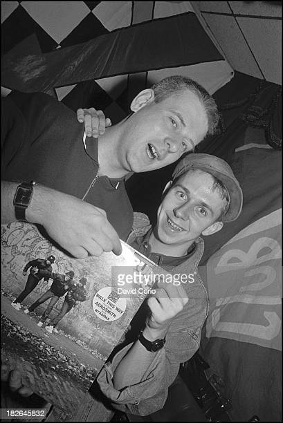 Chris Bangs and Gilles Peterson holding RUN DMC's 'Walk This Way' 12' single at 'Special Branch' at the Royal Oak Tooley Street London UK 1986