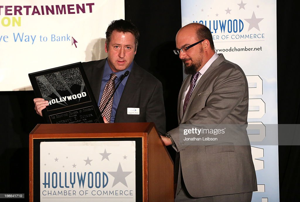 Chris Barton, Chair of the Board, Hollywood Chamber of Commerce (L) presents the Commitment to California Award to Anthony E. Zuiker, Creator/Executive Producer of CSI onstage at Variety's Hollywood Chamber Entertainment Conference 2012 at Loews Hollywood Hotel on November 16, 2012 in Hollywood, California.