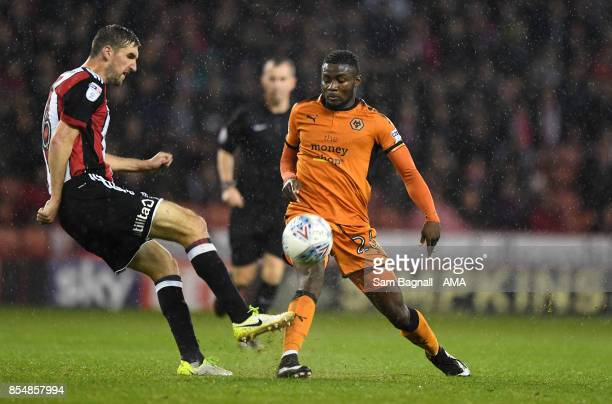 Chris Basham of Sheffield United and Bright Enobakhare of Wolverhampton Wanderers during the Sky Bet Championship match between Sheffield United and...