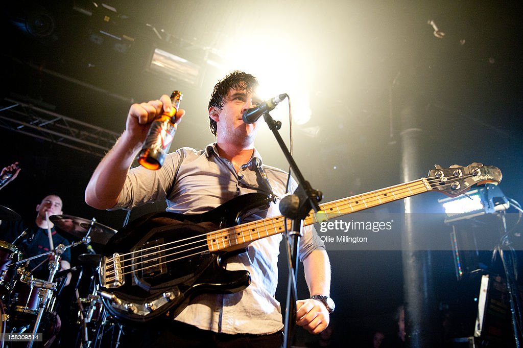 Chris Batten of Enter Shikari Performs onstage showing off the bands beer during a day of the 5th UK leg of their A Flash Flood of Colour World Tour called A Flash Flood Of Christmas; at Rock City on December 12, 2012 in Nottingham, England.