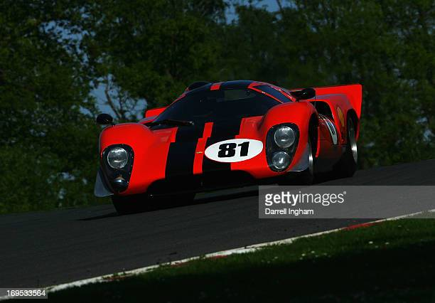 Chris Beighton drives the Lola T70 Mk3b in the FIA Masters Historic Sports Car Championship race during the Masters Historic Festival at the Brands...
