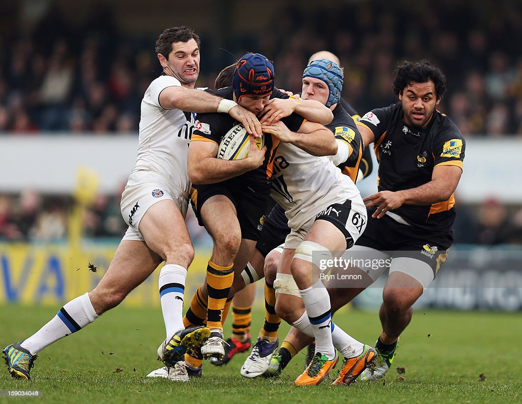 Chris Bell of London Wasps is tackled by Francois Louw of Bath Rugby on his way to scoring a try during the Aviva Premiership match between London Wasps and Bath at Adams Park on January 6, 2013 in High Wycombe, England.