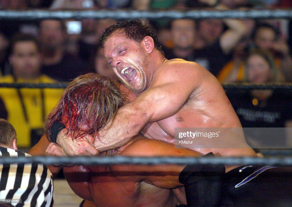 Chris Benoit keeps Triple H in a headlock