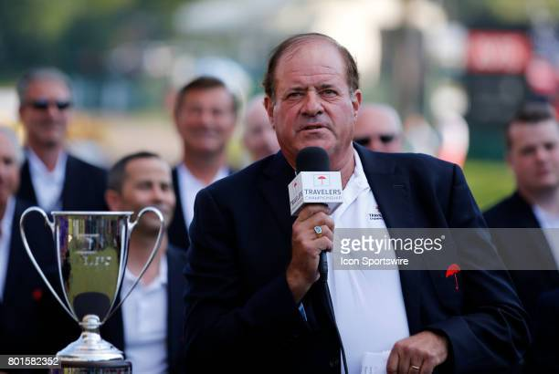 Chris Berman introduces Jordan Spieth of the United States as the winner during the final round of the Travelers Championship on June 25 at TPC River...