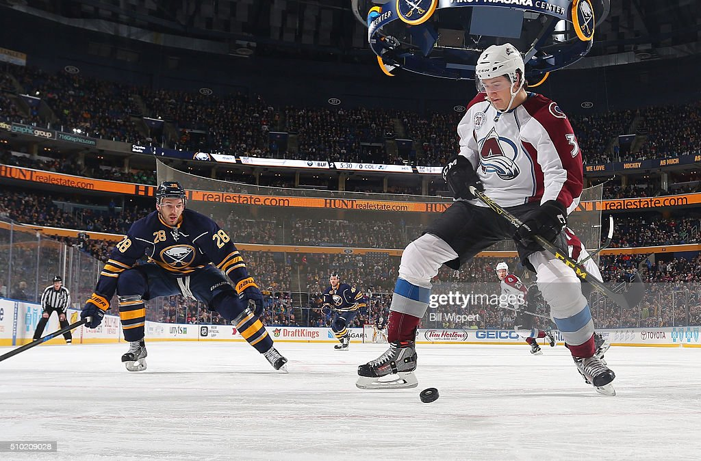 <a gi-track='captionPersonalityLinkClicked' href=/galleries/search?phrase=Chris+Bigras&family=editorial&specificpeople=8814205 ng-click='$event.stopPropagation()'>Chris Bigras</a> #3 of the Colorado Avalanche looks to control the puck against <a gi-track='captionPersonalityLinkClicked' href=/galleries/search?phrase=Zemgus+Girgensons&family=editorial&specificpeople=8050732 ng-click='$event.stopPropagation()'>Zemgus Girgensons</a> #28 of the Buffalo Sabres during an NHL game on February 14, 2016 at the First Niagara Center in Buffalo, New York.