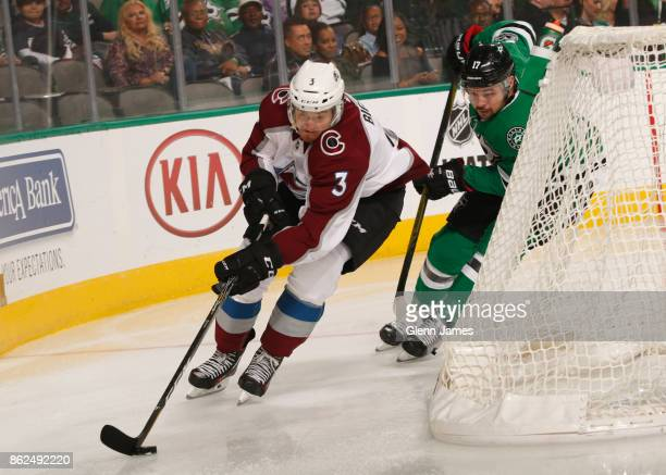 Chris Bigras of the Colorado Avalanche tries to keep the puck away against Devin Shore of the Dallas Stars at the American Airlines Center on October...