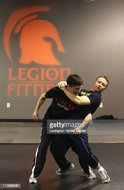 Chris Binder left and Steve Moore practice a Krav Maga technique during class at Legion Fitness in Lexington Kentucky February 26 2008
