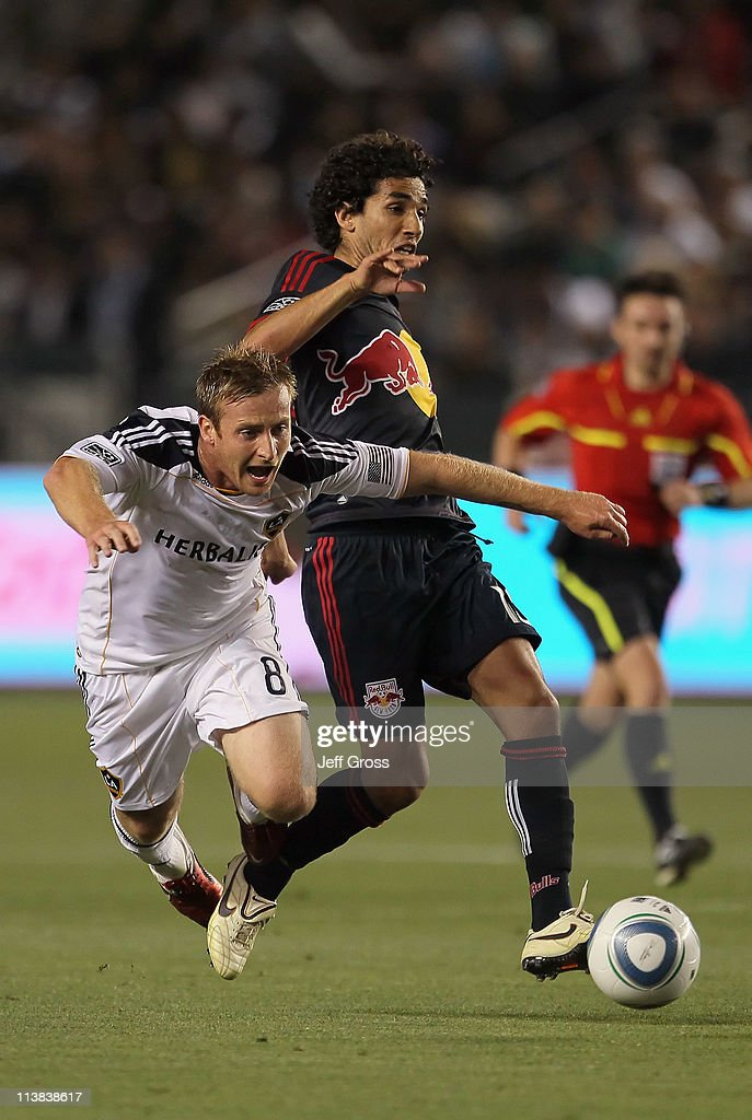 <a gi-track='captionPersonalityLinkClicked' href=/galleries/search?phrase=Chris+Birchall&family=editorial&specificpeople=571523 ng-click='$event.stopPropagation()'>Chris Birchall</a> (L) #8 of the Los Angeles Galaxy is challenged by <a gi-track='captionPersonalityLinkClicked' href=/galleries/search?phrase=Mehdi+Ballouchy&family=editorial&specificpeople=707971 ng-click='$event.stopPropagation()'>Mehdi Ballouchy</a> #10 of the New York Red Bulls for the ball in the second half at The Home Depot Center on May 7, 2011 in Carson, California. The Red Bulls and Galaxy played to a 1-1 draw.