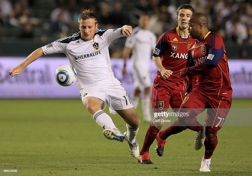 Chris Birchall #11 of the Los Angeles Galaxy controls the ball as Andy Williams #77 of Real Salt Lake pursues in the second half at the Home Depot Center on April 17, 2010 in Carson, California. The Galaxy defeated Real Salt Lake 2-1.