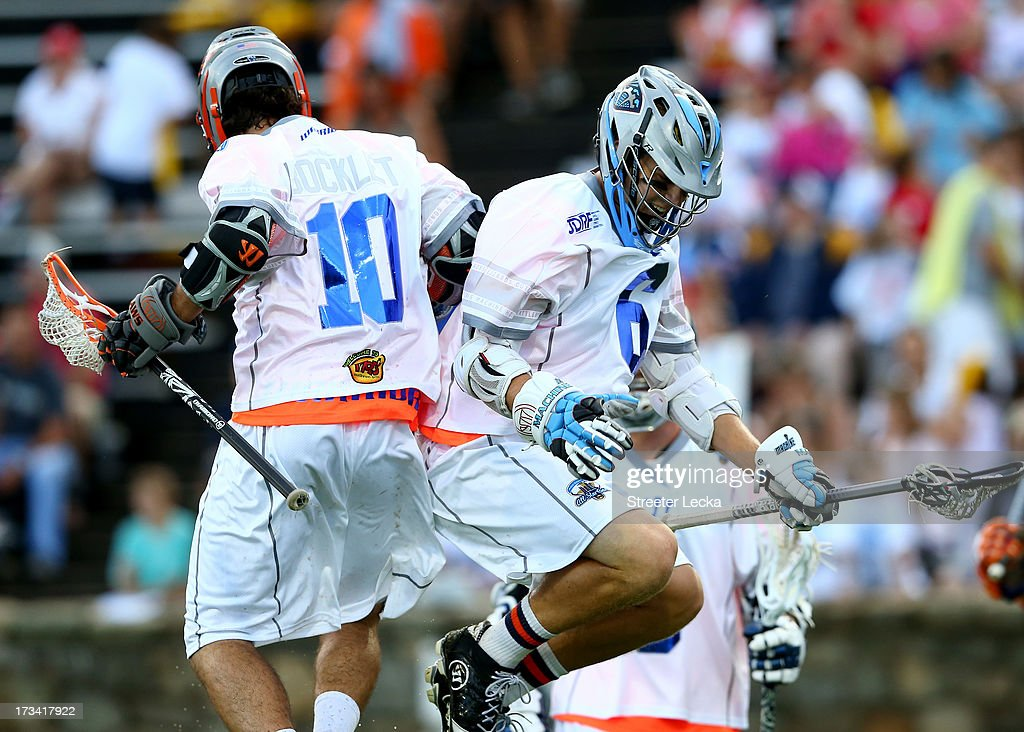 Chris Bocklet #10 celebrates with teammate Steele Stanwick #6 of Supernova after a goal against Eclipse during the 2013 Major League Lacrosse All Star Game at American Legion Memorial Stadium on July 13, 2013 in Charlotte, North Carolina.