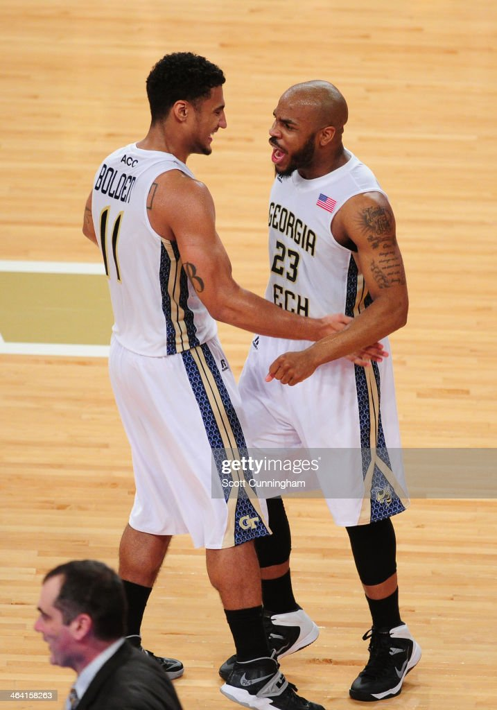 Chris Bolden #11 and Trae Golden #23 of the Georgia Tech Yellow Jackets celebrate after the game against the Notre Dame Fighting Irish at McCamish Pavilion on January 11, 2014 in Atlanta, Georgia. Photo by Scott Cunningham/Getty Images)