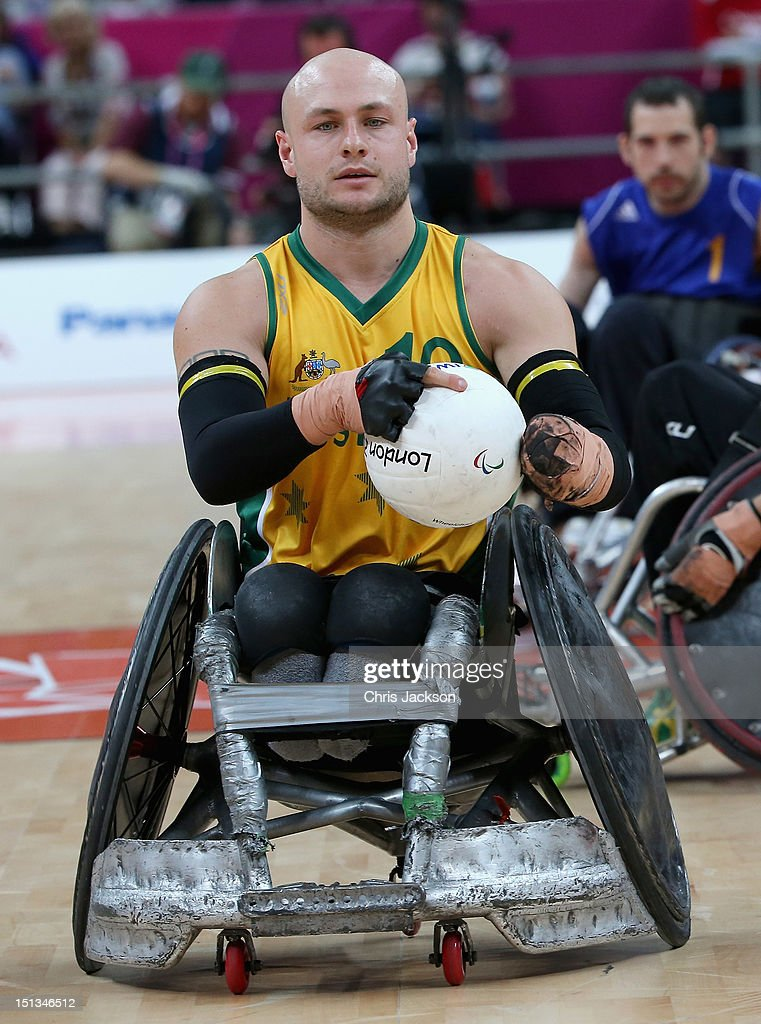Chris Bond of Australia carries the ball during a Paralympic Wheelchair Rugby match against Sweden on day 8 of the London 2012 Paralympic Games at the Basketball Arena on September 6, 2012 in London, England.