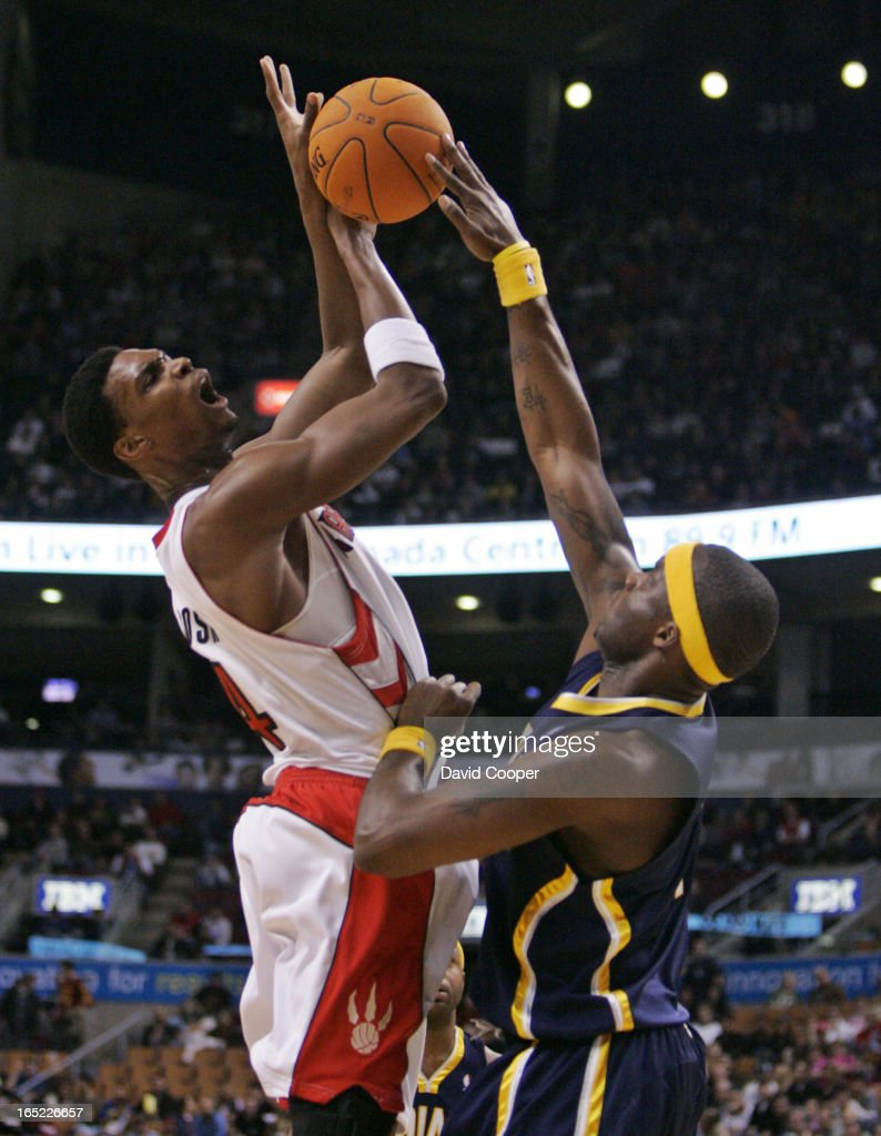 Chris Bosh 4 shooting over Jermaine O Neal 7 o fthe Pacers