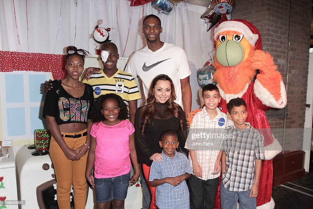 Chris Bosh, Adrienne Bosh and Burnie during the Christmas With Chris Bosh At 'Santa Bosh's Workshop at Game Time at Sunset Place on December 17, 2012 in Miami, Florida.