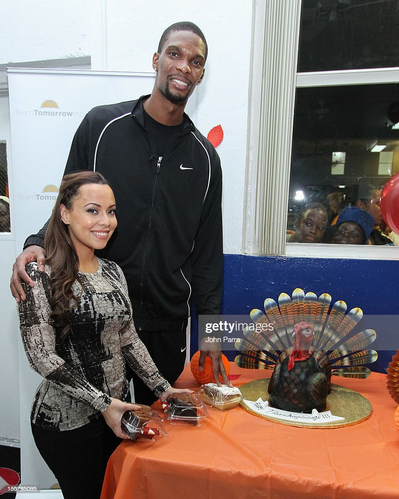 <a gi-track='captionPersonalityLinkClicked' href=/galleries/search?phrase=Chris+Bosh&family=editorial&specificpeople=201574 ng-click='$event.stopPropagation()'>Chris Bosh</a> and Adrienne Bosh attend the 2nd year with the Chapman Partnership to help feed the local families of Miami this Thanksgiving at Chapman Partnership on November 20, 2012 in Miami, Florida.