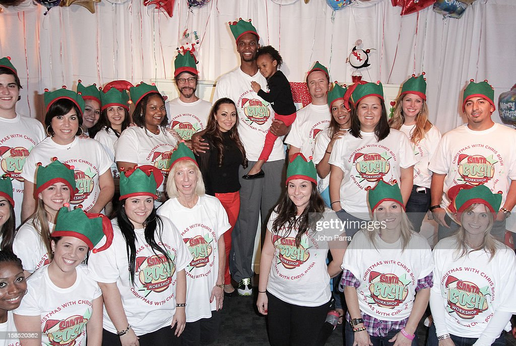 <a gi-track='captionPersonalityLinkClicked' href=/galleries/search?phrase=Chris+Bosh&family=editorial&specificpeople=201574 ng-click='$event.stopPropagation()'>Chris Bosh</a> and Adrienne Bosh during the Christmas With <a gi-track='captionPersonalityLinkClicked' href=/galleries/search?phrase=Chris+Bosh&family=editorial&specificpeople=201574 ng-click='$event.stopPropagation()'>Chris Bosh</a> At 'Santa Bosh's Workshop at Game Time at Sunset Place on December 17, 2012 in Miami, Florida.