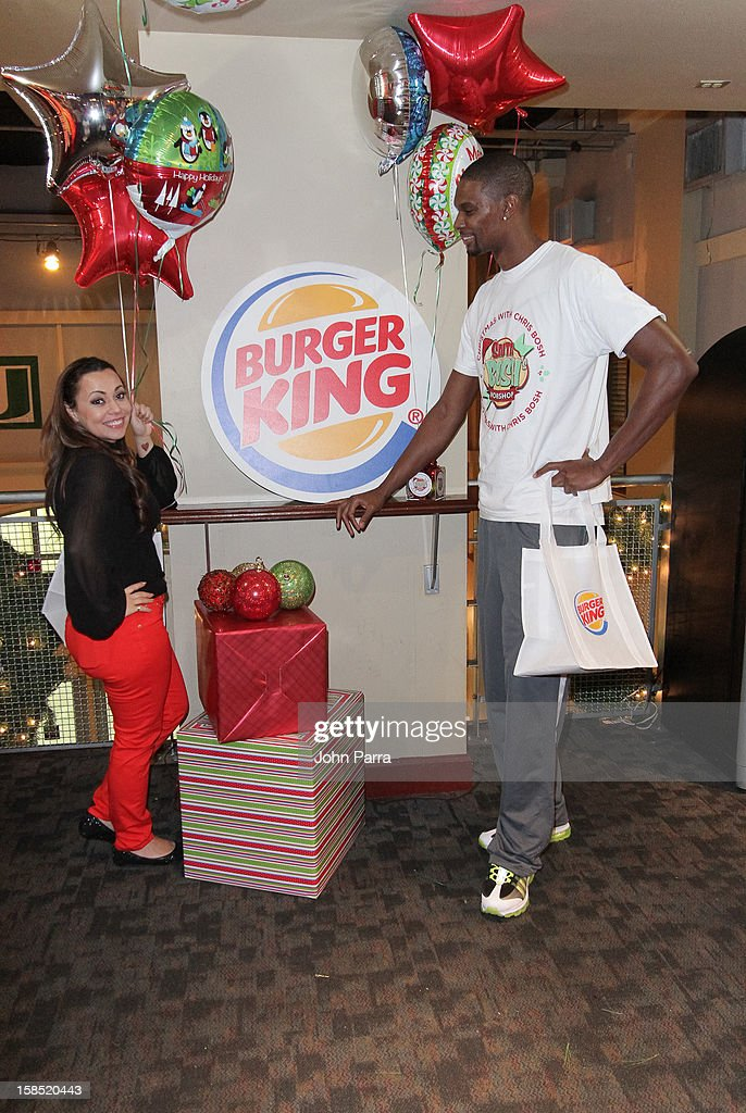 Chris Bosh and Adrienne Bosh during the Christmas With Chris Bosh At 'Santa Bosh's Workshop at Game Time at Sunset Place on December 17, 2012 in Miami, Florida.