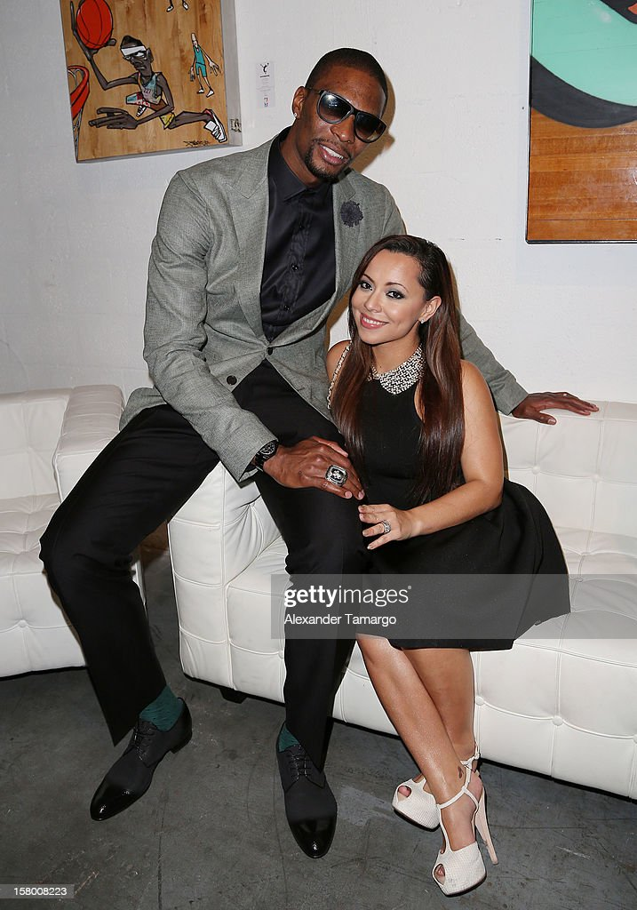 <a gi-track='captionPersonalityLinkClicked' href=/galleries/search?phrase=Chris+Bosh&family=editorial&specificpeople=201574 ng-click='$event.stopPropagation()'>Chris Bosh</a> and Adrienne Bosh make an appearance as Premier Beverage Hosts Art Of Basketball: Heat Wave With Dwyane Wade & <a gi-track='captionPersonalityLinkClicked' href=/galleries/search?phrase=Chris+Bosh&family=editorial&specificpeople=201574 ng-click='$event.stopPropagation()'>Chris Bosh</a> on December 7, 2012 in Miami, Florida.