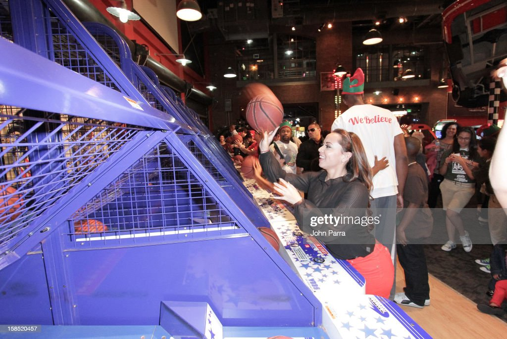 <a gi-track='captionPersonalityLinkClicked' href=/galleries/search?phrase=Chris+Bosh&family=editorial&specificpeople=201574 ng-click='$event.stopPropagation()'>Chris Bosh</a> and Adrienne Bosh playing ball during the Christmas With <a gi-track='captionPersonalityLinkClicked' href=/galleries/search?phrase=Chris+Bosh&family=editorial&specificpeople=201574 ng-click='$event.stopPropagation()'>Chris Bosh</a> At 'Santa Bosh's Workshop at Game Time at Sunset Place on December 17, 2012 in Miami, Florida.
