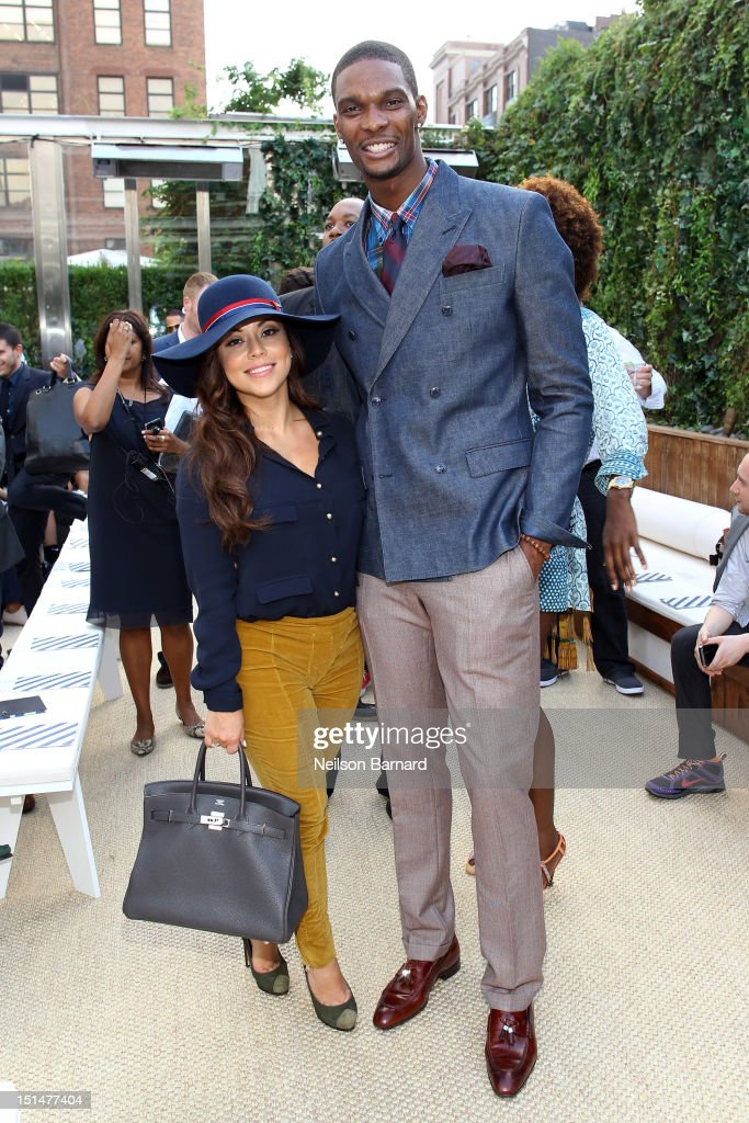<a gi-track='captionPersonalityLinkClicked' href=/galleries/search?phrase=Chris+Bosh&family=editorial&specificpeople=201574 ng-click='$event.stopPropagation()'>Chris Bosh</a> (R) and Adrienne Williams Bosh attend Tommy Hilfiger Men's Spring 2013 Collection at The Maritime Hotel on September 7, 2012 in New York City.
