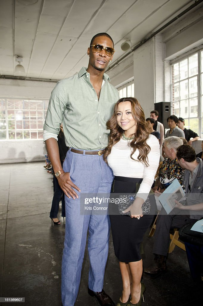 Chris Bosh and Adrienne Williams pose for a photo during the Duckie Brown Spring 2013 Mercedes-Benz Fashion Week Show at Industria Superstudio on September 6, 2012 in New York City.