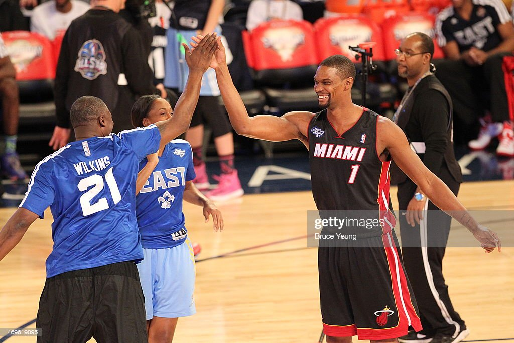 Chris Bosh #1 and Dominique Wilkins #21 of the East Team celebrate during the Sears Shooting Stars Competition on State Farm All-Star Saturday Night as part of the 2014 All-Star Weekend at Smoothie King Center on February 15, 2014 in New Orleans, Louisiana.