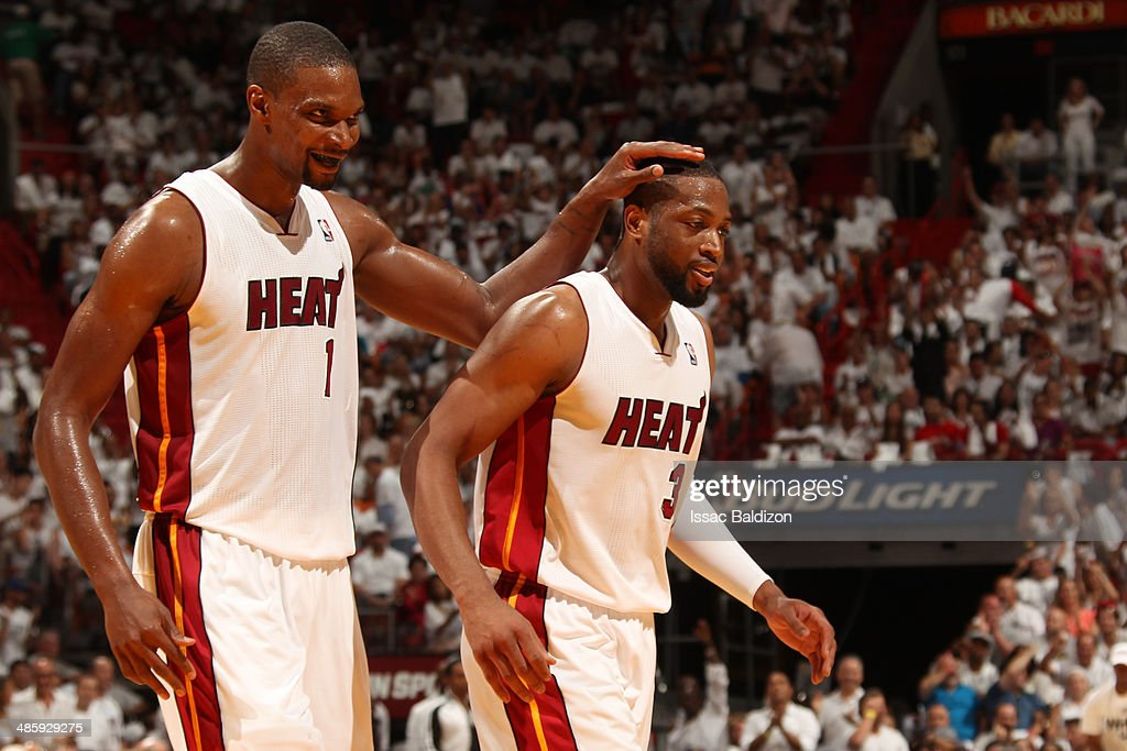 <a gi-track='captionPersonalityLinkClicked' href=/galleries/search?phrase=Chris+Bosh&family=editorial&specificpeople=201574 ng-click='$event.stopPropagation()'>Chris Bosh</a> #1 and <a gi-track='captionPersonalityLinkClicked' href=/galleries/search?phrase=Dwyane+Wade&family=editorial&specificpeople=201481 ng-click='$event.stopPropagation()'>Dwyane Wade</a> #3 of the Miami Heat celebrate against the Charlotte Bobcats during Game One of the Eastern Conference Quarterfinals of the 2014 NBA playoffs at the American Airlines Arena in Miami, Florida on April 20, 2014.