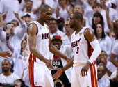 Chris Bosh and Dwyane Wade of the Miami Heat celebrate in the second quarter while taking on the San Antonio Spurs during Game Seven of the 2013 NBA...