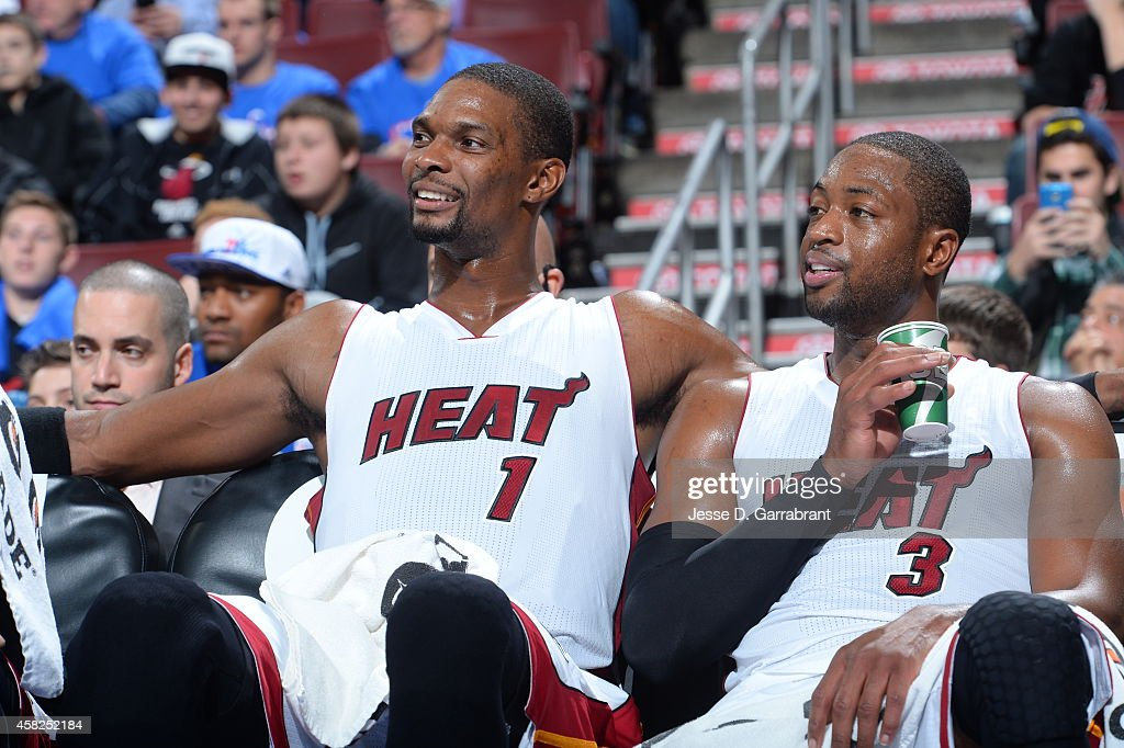 <a gi-track='captionPersonalityLinkClicked' href=/galleries/search?phrase=Chris+Bosh&family=editorial&specificpeople=201574 ng-click='$event.stopPropagation()'>Chris Bosh</a> #1 and <a gi-track='captionPersonalityLinkClicked' href=/galleries/search?phrase=Dwyane+Wade&family=editorial&specificpeople=201481 ng-click='$event.stopPropagation()'>Dwyane Wade</a> #3 of the Miami Heat look on during the game against the Philadelphia 76ers on November 1, 2014 at the Wells Fargo Center in Philadelphia, Pennsylvania.