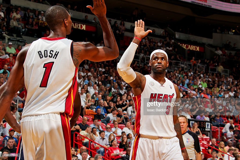 Chris Bosh #1 and LeBron James #6 of the Miami Heat celebrate while playing the Washington Wizards on January 6, 2013 at American Airlines Arena in Miami, Florida.