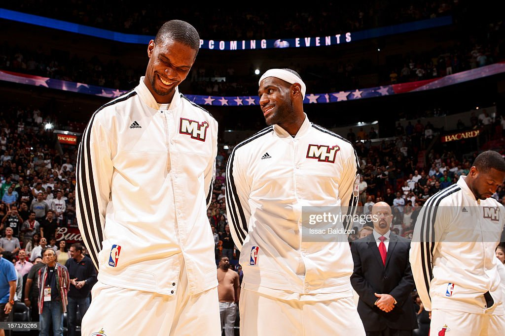 Chris Bosh #1 and LeBron James #6 of the Miami Heat share a laugh before a game against the San Antonio Spurs on November 29, 2012 at American Airlines Arena in Miami, Florida.