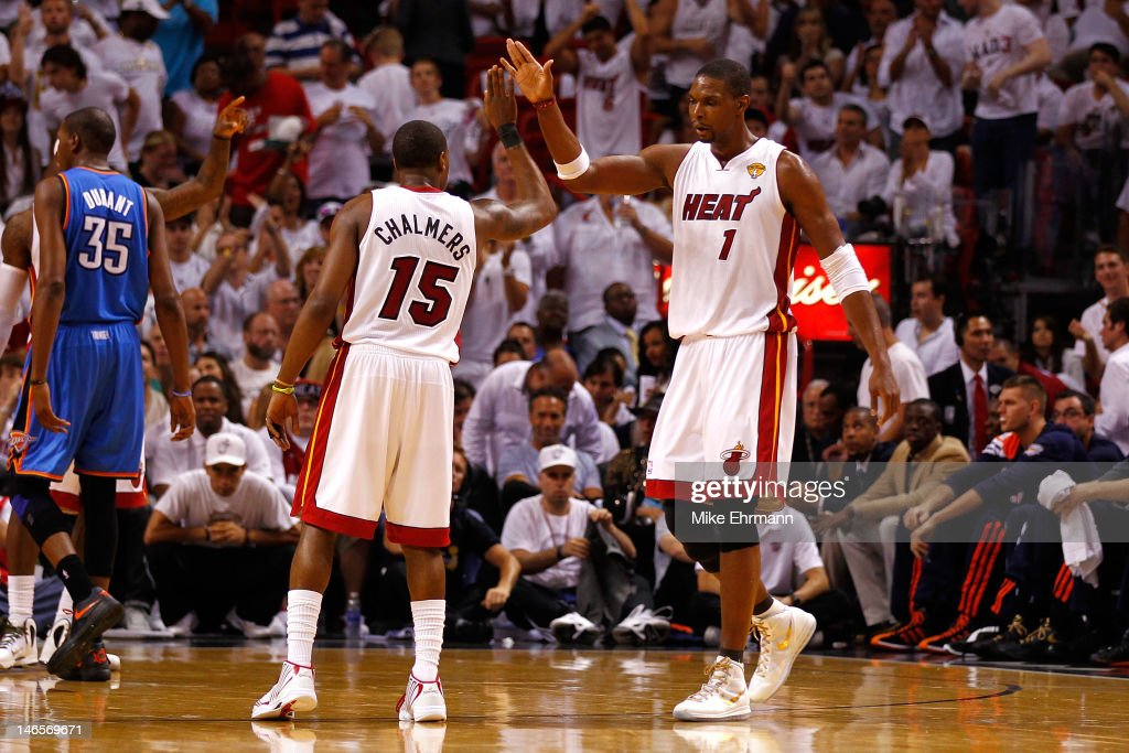 Chris Bosh and Mario Chalmers of the Miami Heat celebrate a play in the second half against the Oklahoma City Thunder in Game Four of the 2012 NBA...