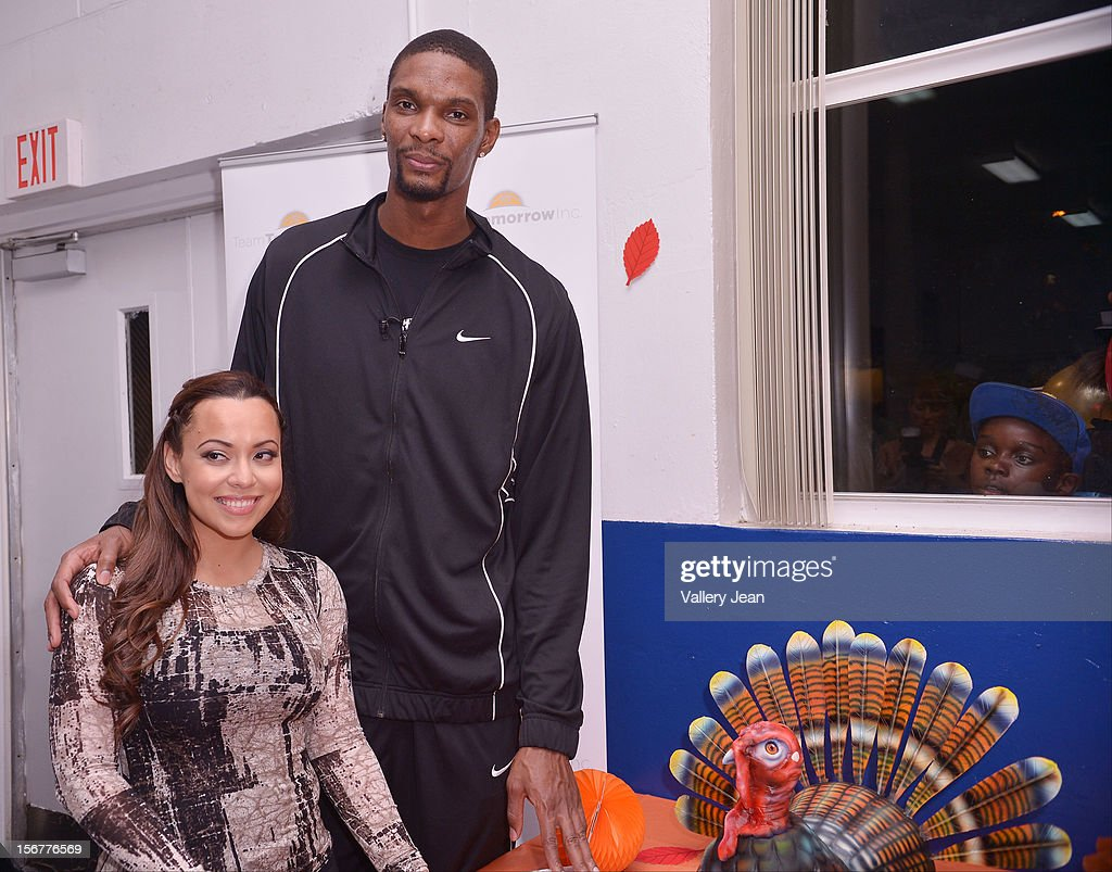 <a gi-track='captionPersonalityLinkClicked' href=/galleries/search?phrase=Chris+Bosh&family=editorial&specificpeople=201574 ng-click='$event.stopPropagation()'>Chris Bosh</a> (R) and wife Adrienne Bosh and Team Tomorrow Inc. team up for the 2nd year with Chapman Partnership to feed the local families of Miami this Thanksgiving on November 20, 2012 in Miami, Florida.