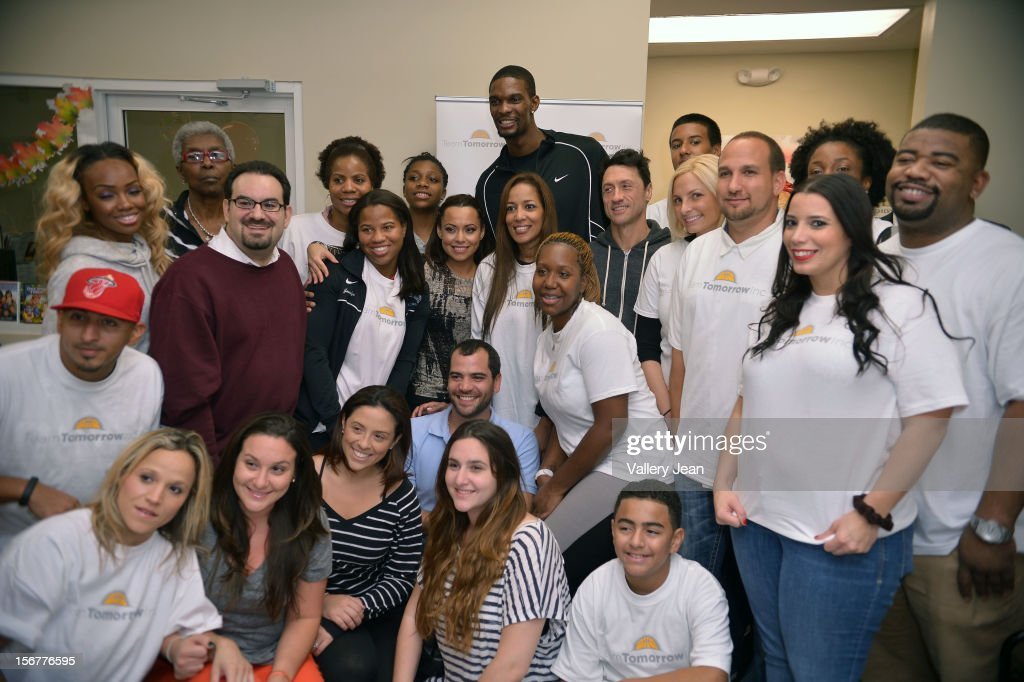 <a gi-track='captionPersonalityLinkClicked' href=/galleries/search?phrase=Chris+Bosh&family=editorial&specificpeople=201574 ng-click='$event.stopPropagation()'>Chris Bosh</a> and wife Adrienne Bosh and Team Tomorrow Inc. team up for the 2nd year with Chapman Partnership to feed the local families of Miami this Thanksgiving on November 20, 2012 in Miami, Florida.