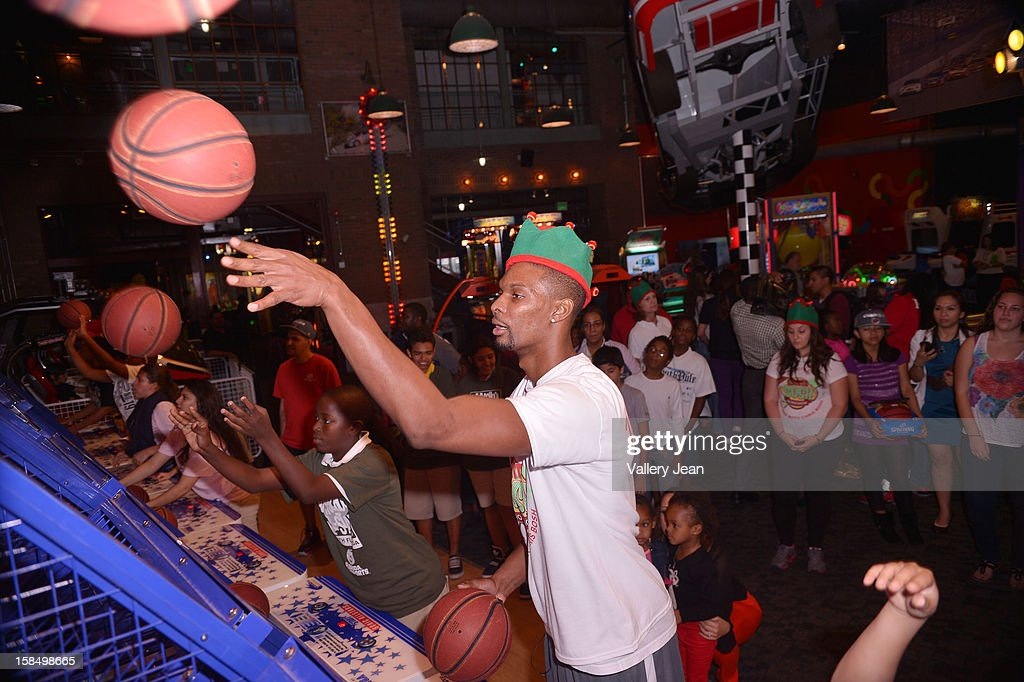 <a gi-track='captionPersonalityLinkClicked' href=/galleries/search?phrase=Chris+Bosh&family=editorial&specificpeople=201574 ng-click='$event.stopPropagation()'>Chris Bosh</a> attends the 'Santa Bosh's Workshop' Celebration at Game Time at Sunset Place on December 17, 2012 in Aventura, Florida.