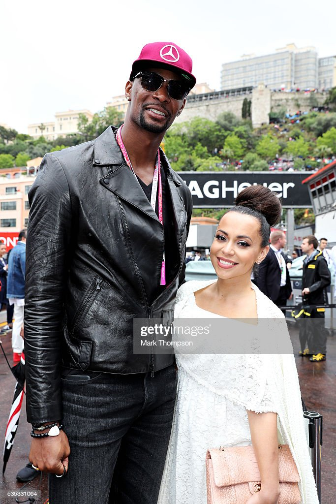 <a gi-track='captionPersonalityLinkClicked' href=/galleries/search?phrase=Chris+Bosh&family=editorial&specificpeople=201574 ng-click='$event.stopPropagation()'>Chris Bosh</a>, basketball player and his wife, <a gi-track='captionPersonalityLinkClicked' href=/galleries/search?phrase=Adrienne+Bosh&family=editorial&specificpeople=7508479 ng-click='$event.stopPropagation()'>Adrienne Bosh</a>, in the Pitlane before the Monaco Formula One Grand Prix at Circuit de Monaco on May 29, 2016 in Monte-Carlo, Monaco.